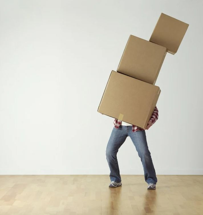 person carrying cardboard boxes